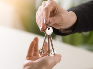 handing over keys to someone