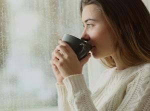 women drinking coffee by window